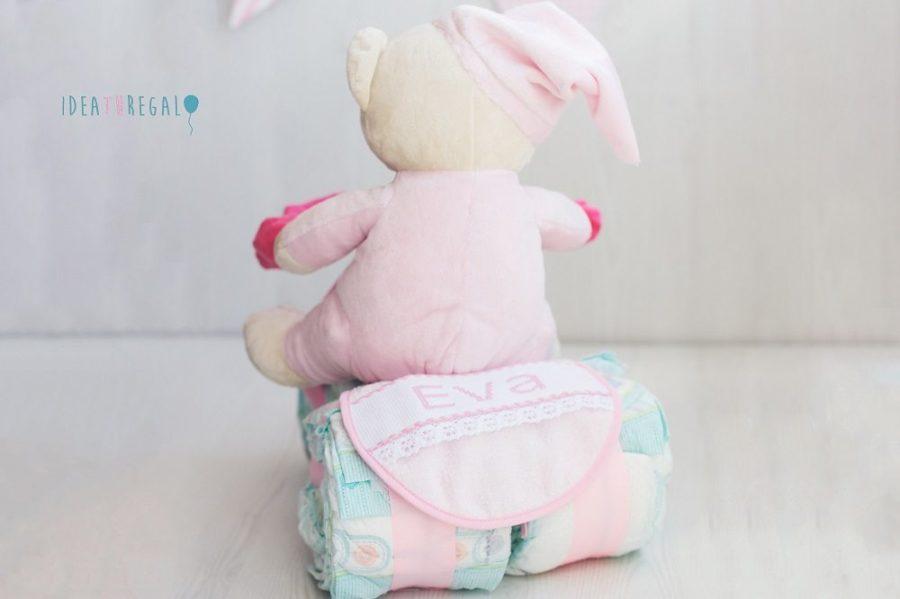 Moto de pañales con peluche en rosa